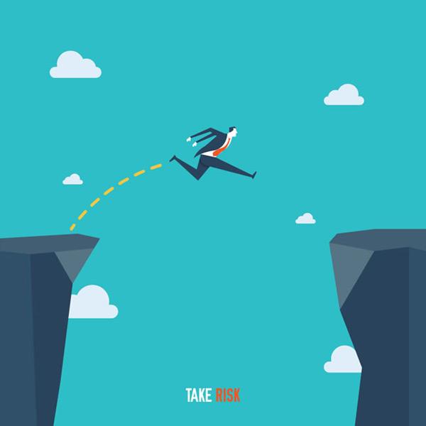 商务人物跳跃悬崖